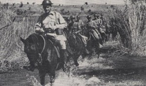 "Captain John Wheeler leading the Machine Gun Troop of the 26th Cavalry Regiment(PS)(Horse) just prior to the Japanese invasion. From the cover of the March/April, 1943 issue of ""The Cavalry Journal,"" published online in the Philippine Scouts Heritage Society website."